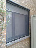 Mosquitera enrollable en ventana